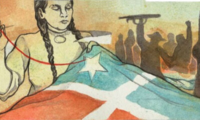 """""""End the Debt! Decolonize! Liberate Puerto Rico!"""" a hand-illustrated scroll over 170 feet long and 3 inches wide"""