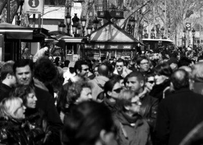 Locals and tourists heavily traffic La Rambla, a 1.2 kilometer pedestrian street running through Barcelona's city center.